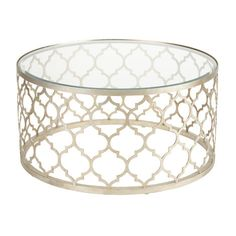 Ethan Allen: We've drummed up something extraordinary!  Influenced by Moroccan patterns, this drum-style coffee table is a brilliant fusion of modern form and Old-World embellishments. An open quatrefoil pattern framework base hand-finished in a silver leafing and a beveled glass top lend the piece a distinctly exotic quality.