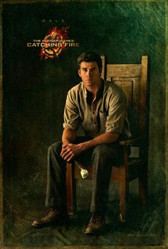 Liam Hemsworth also holds a white rose as Gale.