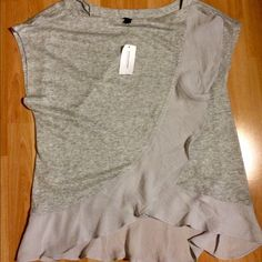 NWT Banana Republic size L gray faux split tank Beautiful w/ tags gray lightweight sweater faux split tank(made of modal ) in gray with gorgeous ruffle detail on the edges. NWT and is a size L Banana Republic Tops