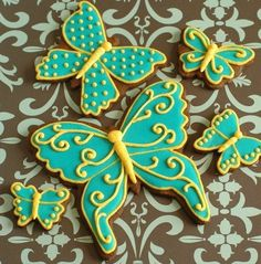 Butterfly decorated sugar cookies. Royal icing. Green, yellow.