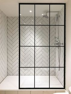 I'm in love with the herringbone tile and the amazing crittall shower screen from Creative Glass Studio in London Modern Bathroom Tile, Mosaic Bathroom, Bathroom Interior Design, Mosaic Tiles, Bathroom Showers, Bathroom Glass Wall, Master Bathroom, Bathroom Lighting, Bathroom Subway Tiles