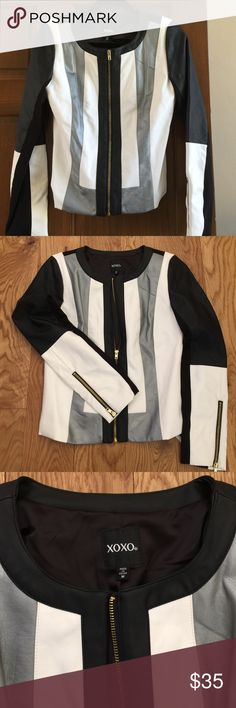 """NWT beautiful faux leather jacket from XOXO NWT. Faux leather jacket. Size M in Junior. Amazing cut and color. Black, white and silver with gold zipper at front and cuffs. Black lining. Super soft. 18"""" from armpit to armpit and 21"""" from shoulder to bottom of jacket. XOXO Jackets & Coats"""