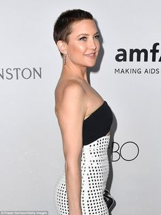 Plans on 'bringing back the mullet': The buzzcut brunette sported lashes, blush, highlighter, and diamond earrings which were likely Jennifer Meyer