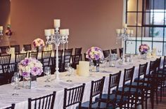 Love the long tables, black chairs and the lavendar centerpieces...simple and chic!