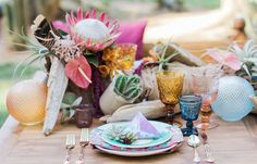 A true boho tablescape! We love the color palette here.