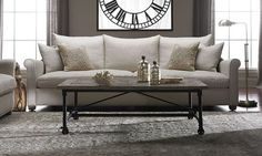 Classic sofa features 8 way, hand-tied coils,  plush feather down blend cushioning, and a natural linen upholstery