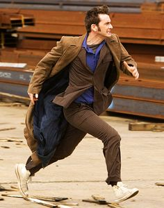 This is my Doctor. The crazy hair, the suit and the chucks, the long brown trench coat flying behind him.. Basically...Run!
