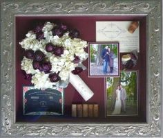 Paris storybook from Forever Flowers, Boca Raton FL. This story takes place over one year.  The engagement picture under a tree on a river in Paris.  A year later under the same tree with wedding gown. Wine corks from the honeymoon visits to French vineyards. Announcement and invitation also included with the flowers. Shadowbox is the Nouveau Antique Silver frame, Maroon Sheer Silk background, and Museum Glass.