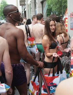 """Shoppers wearing only their underwear wait in line outside a Desigual clothing store on June 14, 2012 in Dusseldorf, Germany. The store, as a promotional event under the motto """"Get undressed, we'll dress you!"""", was offering the first 100 scantily-clad shoppers a free outfit of their choice. (Photos: Juergen Schwarz)"""