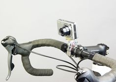 Love bikes as much as you love cameras? Cycling company Minoura has a beautiful accessory called the Quick Release Camera Mount. It's a simple product that turns your bike into a tripod biwheel without sacrificing any aesthetics. It holds your camera securely to your handlebar using a standard quarter-inch threaded bolt, and features a front-wheel-style quick release clamp that allows you to quickly mount and unmount it.