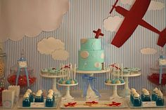 Beautiful Table ~ I especially love the fabric making up the backdrop...and the clouds.  So cute!