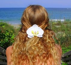 Perfect for a beach wedding or just a day at the beach. A beautiful white orchid flower on a french style barrette. Looks so real! You'll be an Island Princess wearing this flower in your hair.  $16.50
