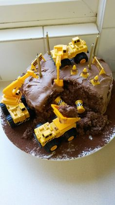 Construction cake for our Bob the builder mad 4yr old. Mary Berry chocolate sponge with buttercream icing destroyed by eBay toys!