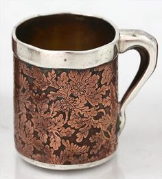 Detail of acid-etched copper cup from: Tiffany & Company sterling silver and mixed metal set of demitasse cups with French touch marks on the rims. Three are decorated with mokume and three are decorated with acid etched copper designs. New York, c1880 (Britannia Silver)