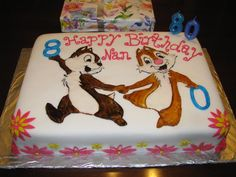 Maybe an idea for Tyler's upcoming Bday.  He's on a Chip and Dale kick right now.  The cake was covered in fondant, the flowers were cut out of dyed gum paste and Chip and Dale were cut out of gum paste and then painted them with icing dye.