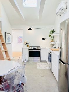 A Tiny Denver House Looks Bigger Than 400 Square Feet   This tiny home blends minimalism and modern decor. Making small spaces work to fit in different aspects of your home from the bedroom to the kitchen.