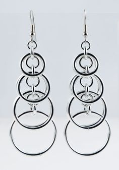 """If you like big earrings, what's not to love about these eye-catching hoops? Deceptively lightweight, these earrings match any outfit and are sure to garner many compliments. Aluminum with surgical steel earwire. Approx. 2.5"""" long not including earwire."""