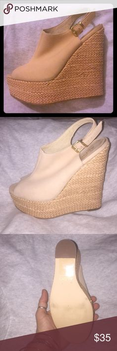 Size 8 ALDO wedges only worn a couple of times. Size 8. Tan wedges. Barely worn. Selling because too tall for me.. beautiful shoes would go with so much! Aldo Shoes Wedges