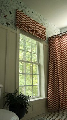 Wainscoting - want to do this in downstairs bathroom. Love the pattern on the window shade & shower curtain! room by Shannon Berrey