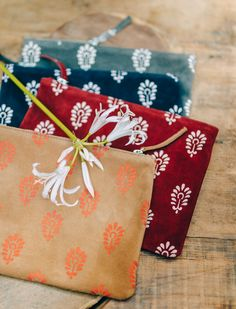 Merci leather clutches printed with a indian flower pattern