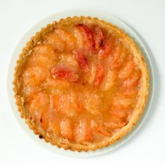 Sweet peaches on top of a olive oil shortbread crust with a hint of almond.