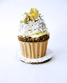 """""""Cupcake With Yellow Buttercream, Coconut, and Yellow Fondant Flowers"""". 100% recycled cardboard."""