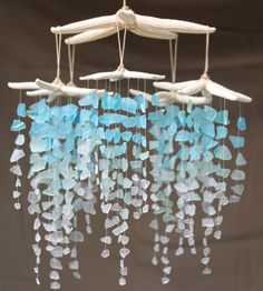 This is from the Etsy artist the Rubbish Revival. Her pieces are absolutely gorgeous! Mobile – via Etsy