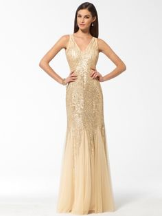 Gleaming champagne sequins rain down on this floaty gown that flaunts a seductive open back. Mermaid silhouetteV-neckSequins over meshIllusion panels on sides<…