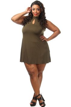 This cute plus size dress features a solid body, front keyhole and a flared mini bottom. Soft, stretch material Loose fit 92% Rayon 8% Spandex Model wearing 3X Made in USA