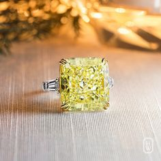 Harry Winston The magnificence of the 28.16 ct. Yellow Diamond Ring with tapered baguettes.