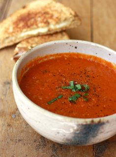 Homemade tomato soup recipe with a grilled cheese sandwich on the side