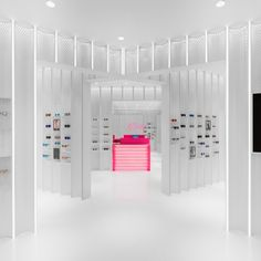 N3ON: Project: N3ON Architect: Linehouse Project Location: Shanghai, China Project Date: 2016Playing with the perception of ocular perception (which is the sense of sight perceived by the eye), this all white interior with white fixtures and forced perspectives where the only accent of colors are the focus point at entry - the cashier desk, new arrivals, and the eye glasses themselves. Mirrors reflecting the perspectives in this space makes this shop feel fast-paced...  [L]