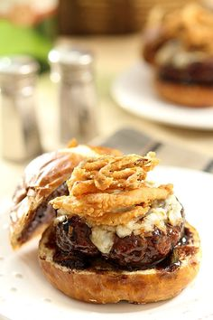Lamb Burger with Goat Cheese and Onion Rings topped with a Cabernet BBQ Sauce