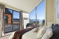 Tewa master bedroom with high ceilings and outdoor access...