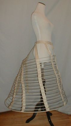 """1860s cage crinoline, ebay seller fiddybee; polished cotton & cotton covered wire hoops, front tie closure, one period mend on waistband and 4 inch period mend on the back strap; waist: 30""""; length: 32""""; hem width: 100"""""""