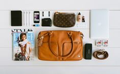 Justine Cullen, Editor-in-Chief of #Elle Magazine, reveals her must-haves to take her workspace on the move with the Classic Shoulder. I really love seeing what's in people's bags.