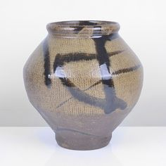 SHIMAOKA TATSUZO Large Vase, Stoneware, impressed chord pattern inlaid with white slip beneath an olive green glaze, rich shiny dark brown splashes over the shoulder, impressed maker's mark, together with a signed wooden Box H 22.5cm, D 21cm