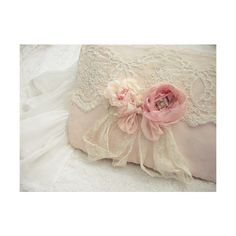 Shabby Chic Pillows - love this detail - soft muslin pillow with border or covering of open flat lace, loose pink ribbon roses, and ribbon.