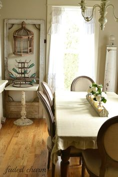 Door frame, architectural column, chick feeder down center of table
