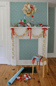 Retro fun, blue and red mantel decorations. Look closely to see the tiny winter scenes created in glass globes.