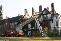 Aftermath: A fire engine is parked outside the wrecked house the morning following the devastating fire. Most of the windows have been blown...