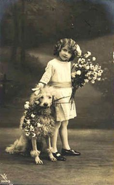 Vintage postcard, girl and a dog, sent in by Susan Frank Vintage images from art-e-zine.co.uk