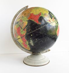 1950s globe with black oceans.