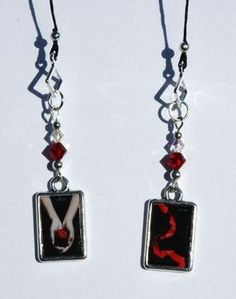 """Twilight saga bookmark book """"thong"""" featuring all four book covers (Twilight/New Moon on one charm & Eclipse/Breaking Dawn on other charm). $9.99"""