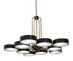 The Ten Light Abbott Chandelier The ten light Abbott is the perfect example of classic modernism in a statement making chandelier. Hand made...