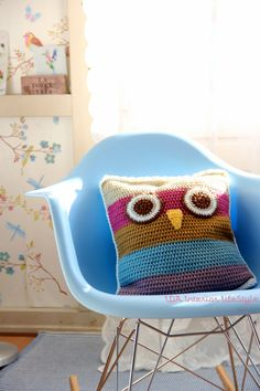 How cute is this owl knitted square pillow? It's so colorful and adorable. Bet you could do something like this with an old sweater pretty easily...
