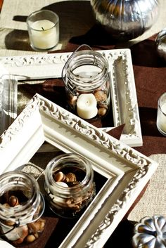 Love the frames as table decor