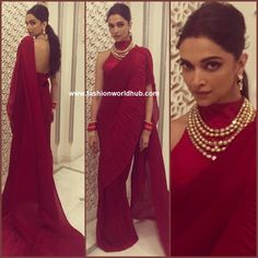 Deepika padukone attended the grand Pre wedding celebrations of Isha Ambani and Anand Piramal's and she was seen in in a maroon saree paired with a sleeveless high neck backless blouse by Faabiiana. Polki diamond jewellery , Red bangles and red sindoor completed her look.