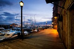 Photo about Pre-dawn light on the Boston harbor walk by Long Wharf. Image of boat, dock, outdoors - 19966816 Boston Tea, Boston Harbor, Open Market, Walking By, Cn Tower, Digital Illustration, Sunrise, Museum, Stock Photos