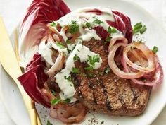 Marinated Flank Steak with Blue Cheese Sauce : At only 310 calories, this dinner proves that steak can be part of a sensible diet. Drizzle each piece with an easy blue cheese and buttermilk sauce and serve with grilled red onion and leaves of radicchio.